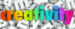 The word Creativity in colorful 3d letters on a background of wh